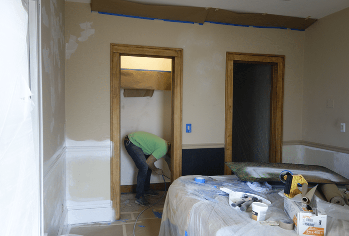 Spraying the closet with primer