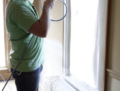 spraying-primer-on-bedroom-trim